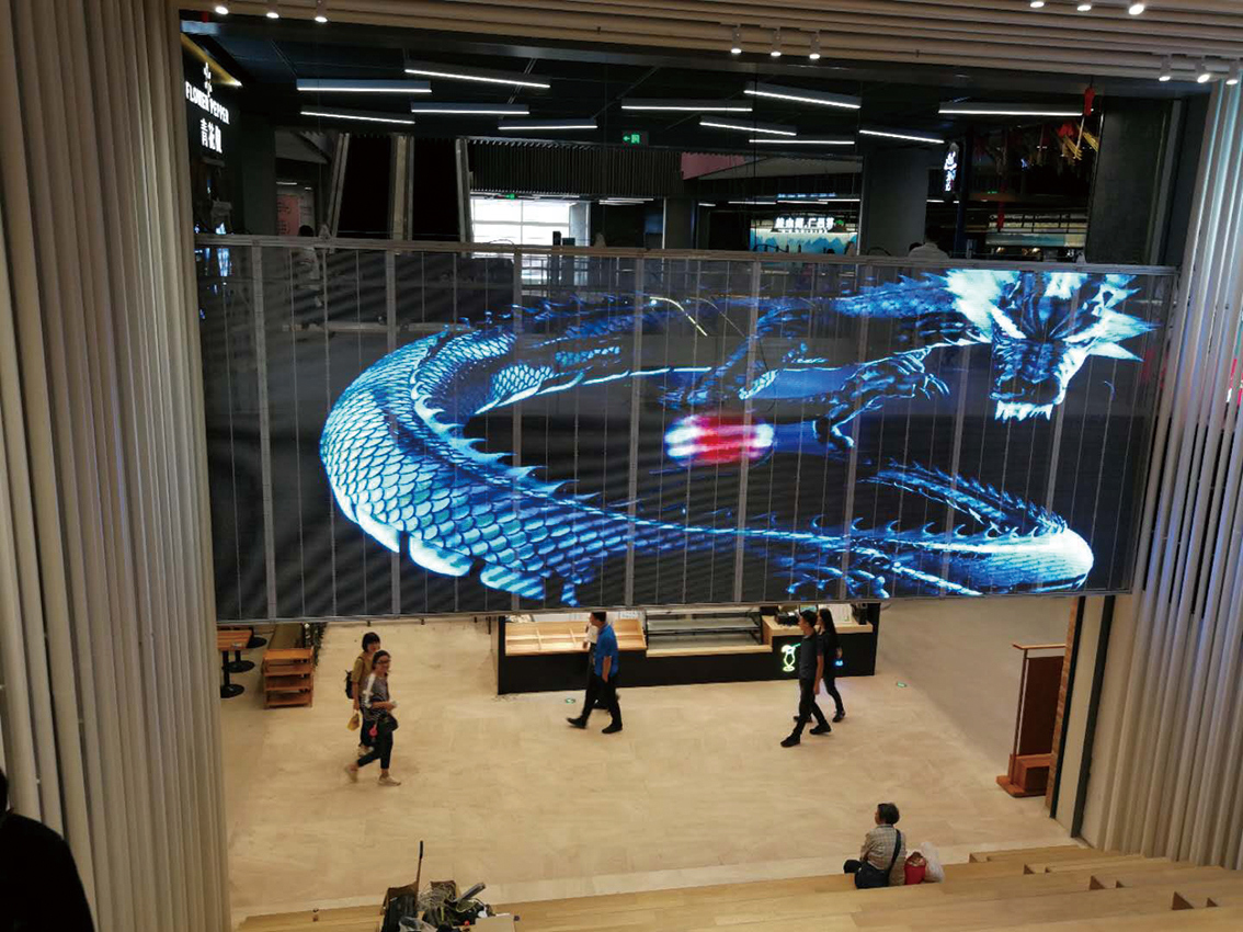 Transparent screen in shopping mall